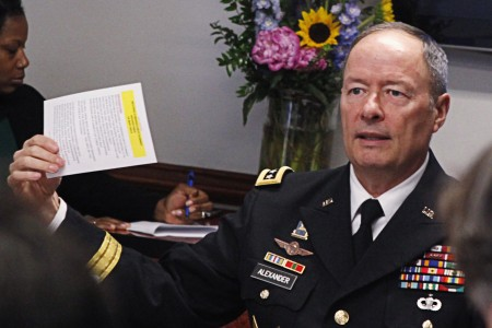 General Alexander, director of the National Security Agency and U.S. Cyber Command, gestures while speaking to reporters during the Reuters Cybersecurity Summit in Washington